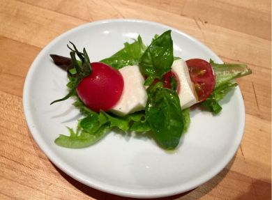 imported burratta cheese local cherry tomatos